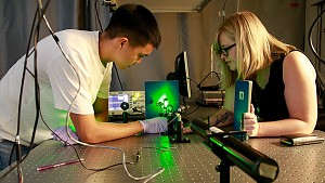 students experimenting with laser